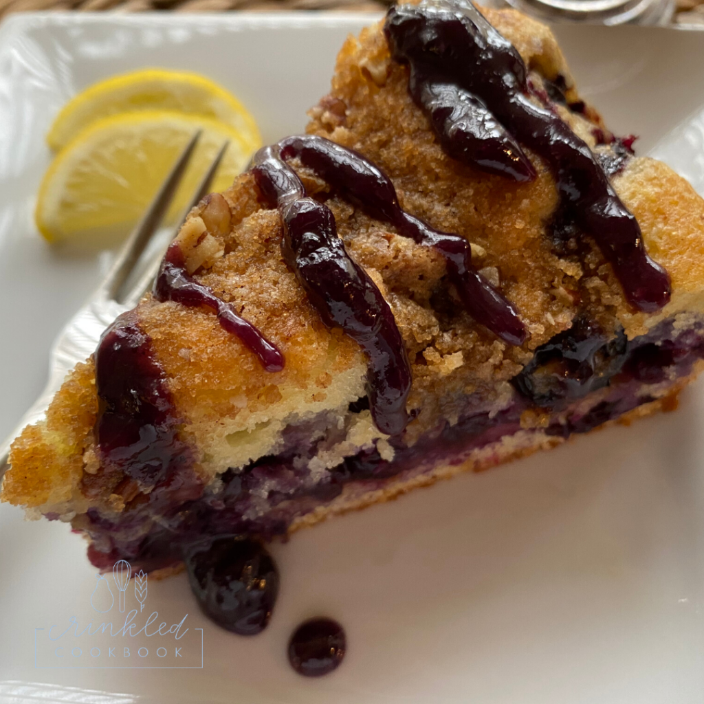 blueberry cake on a plate with lemon garnish