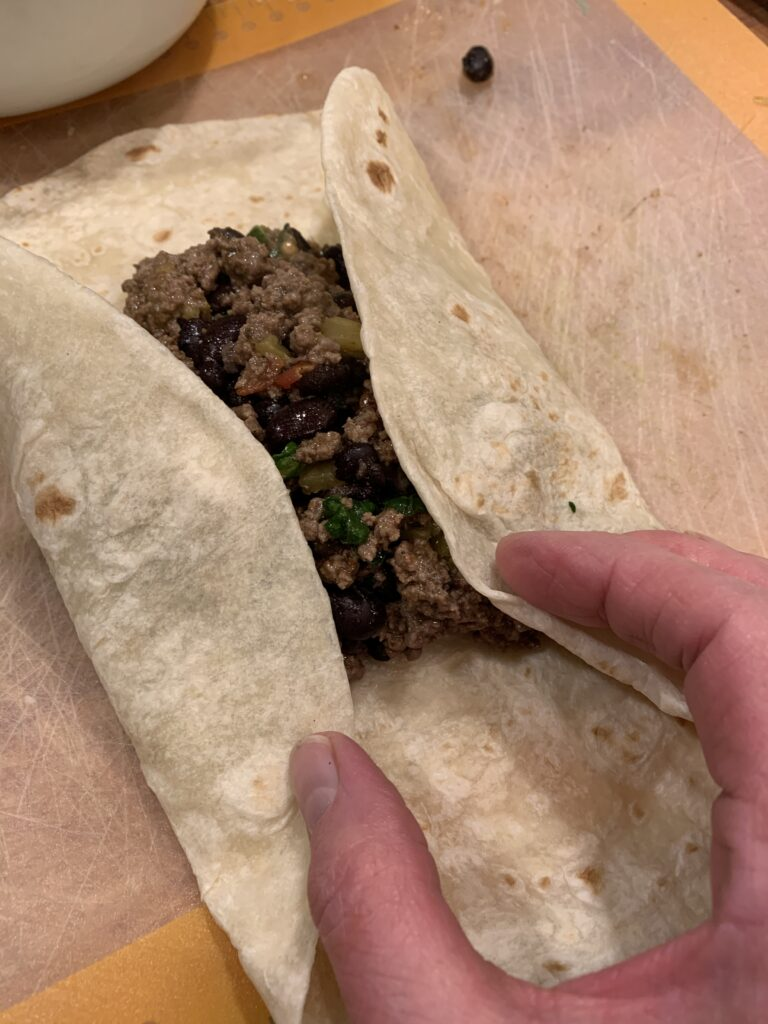 Flour tortilla containing beef filling.