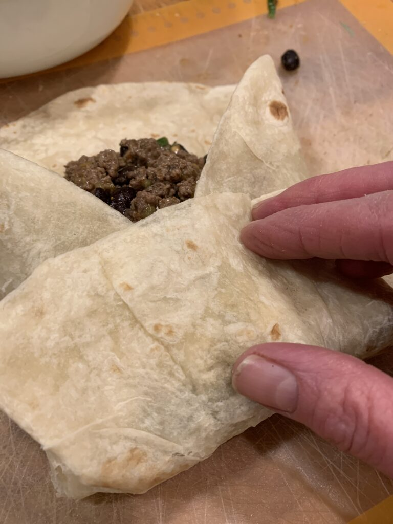 Burrito filing covered by flour tortilla.