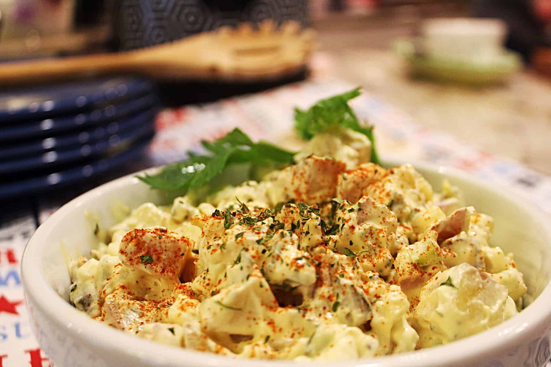 potato salad in a bowl, with parsley garnish