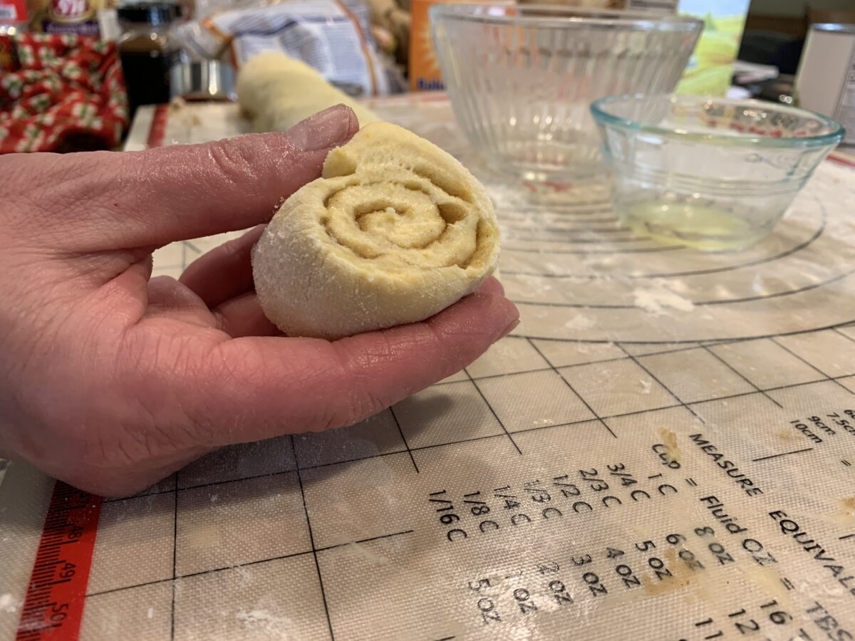 Sliced raw cinnamon roll dough.