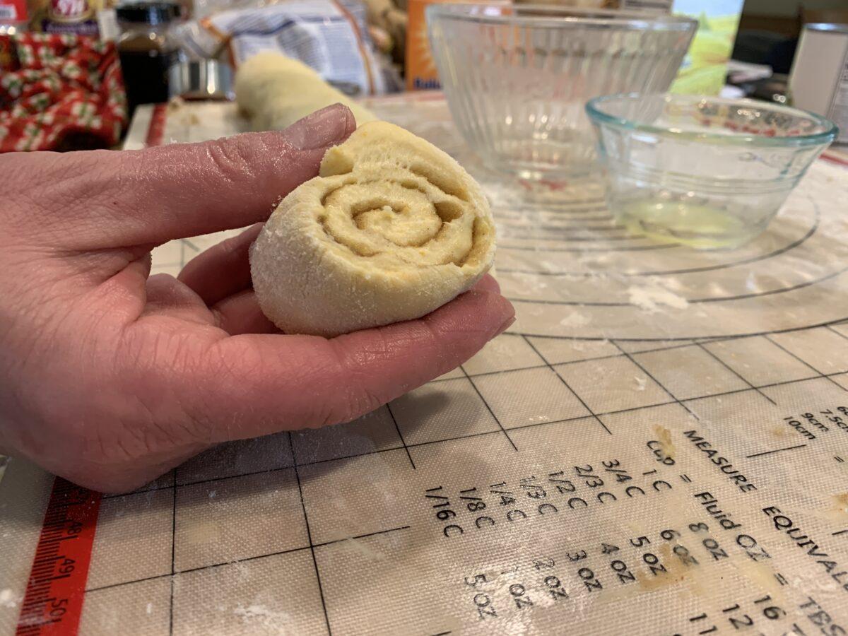 Sliced raw cinnamon roll dough.