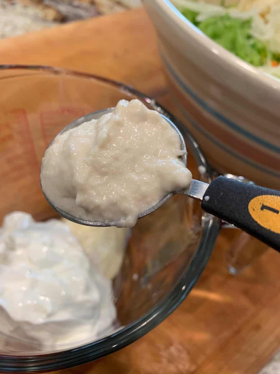 Horseradish in spoon plus cole slaw dressing ingredients.