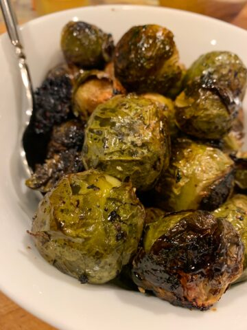 Brussel sprouts on a serving plate with a fork