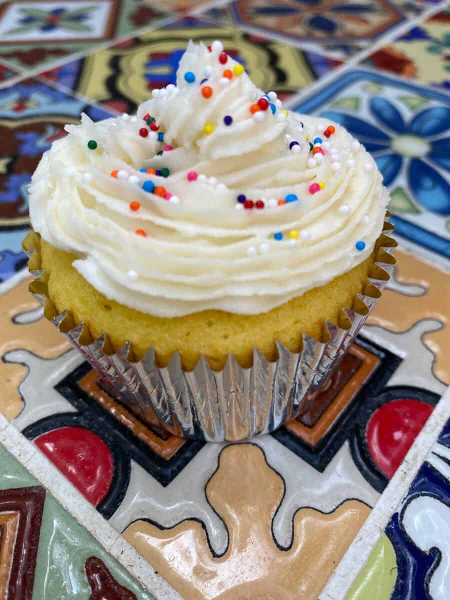 Cupcake with buttercream frosting on top.