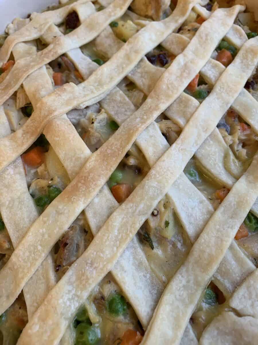 Lattice strips of pie crust on top of a pot pie.