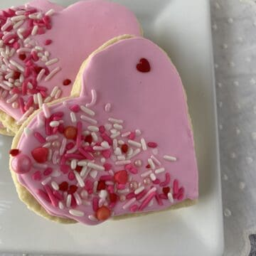 Two sugar cookies on a plate