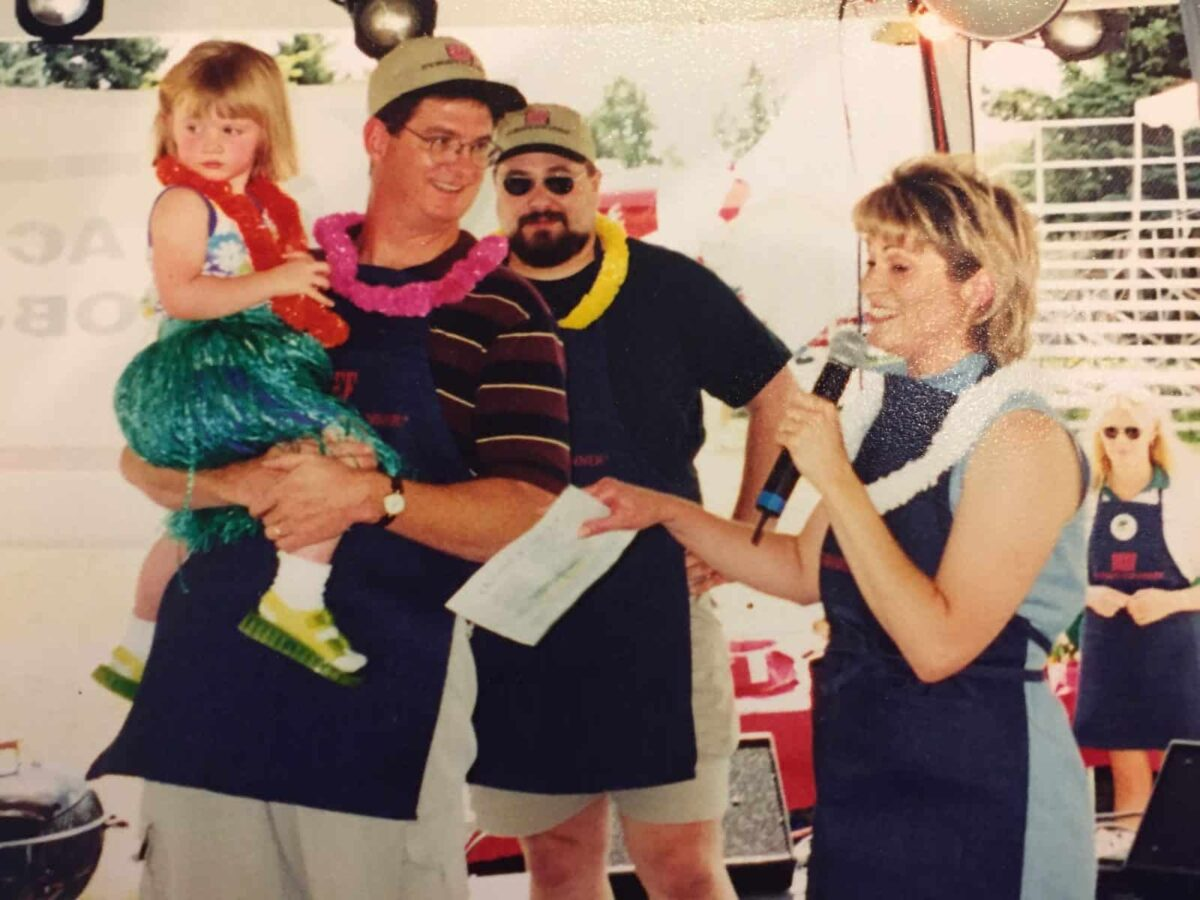 Western Idaho Fair, 1999. Beef Cookoff. Melinda holds a microphone on the stage.