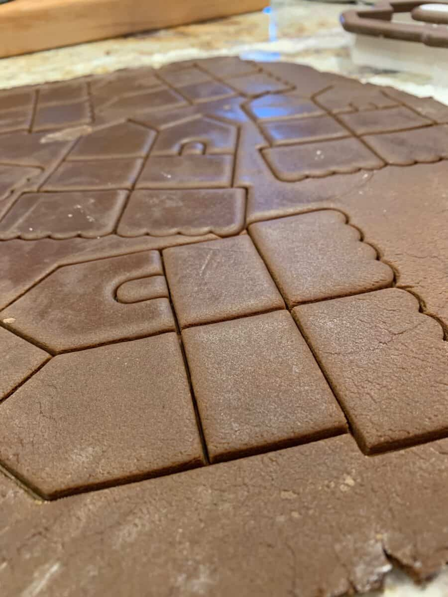 Gingerbread cookie dough with the lines created by the cookie cutter.