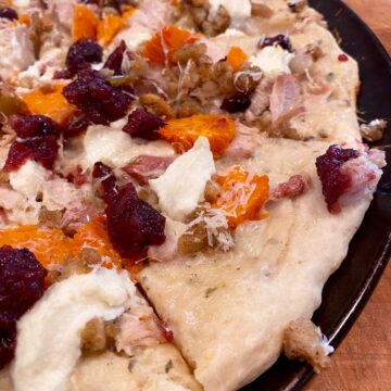 Leftover turkey, sweet potatoes, and ricotta cheese on a pizza crust.