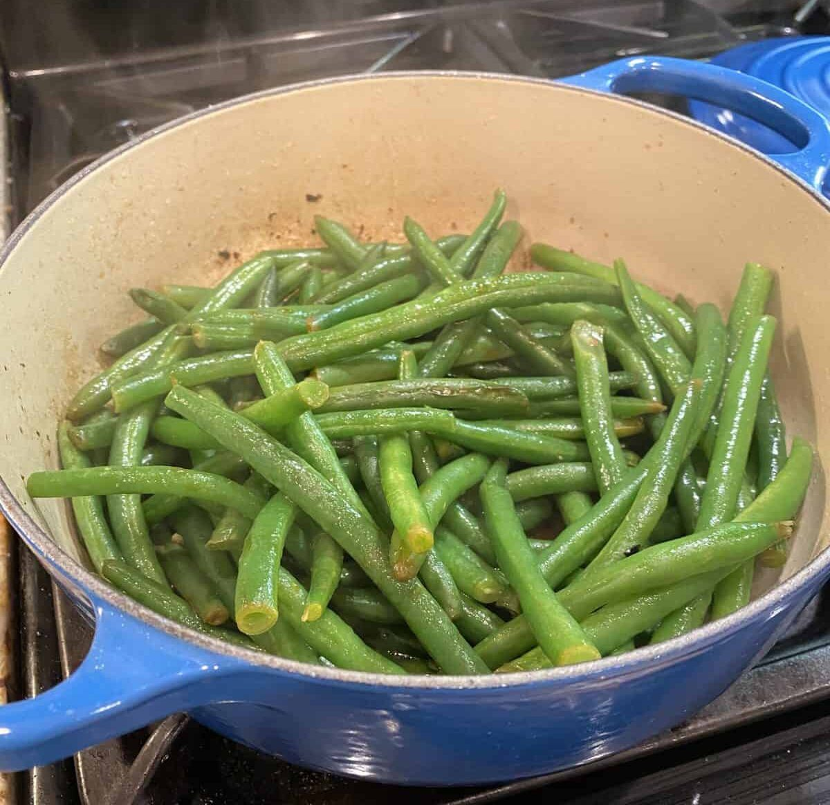 Green beans sautéing on the stove.