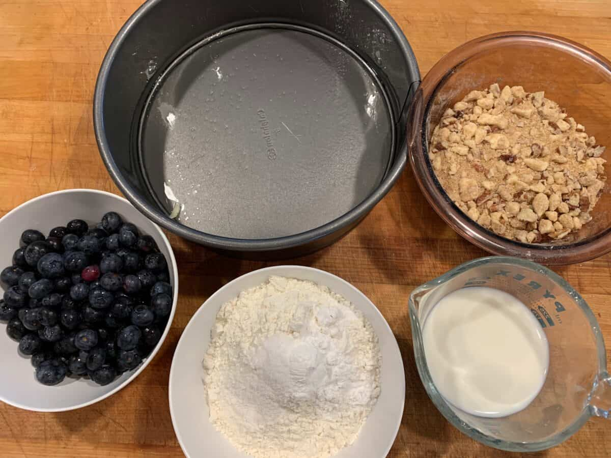 Ingredients for blueberry cake spread out on a cutting board.