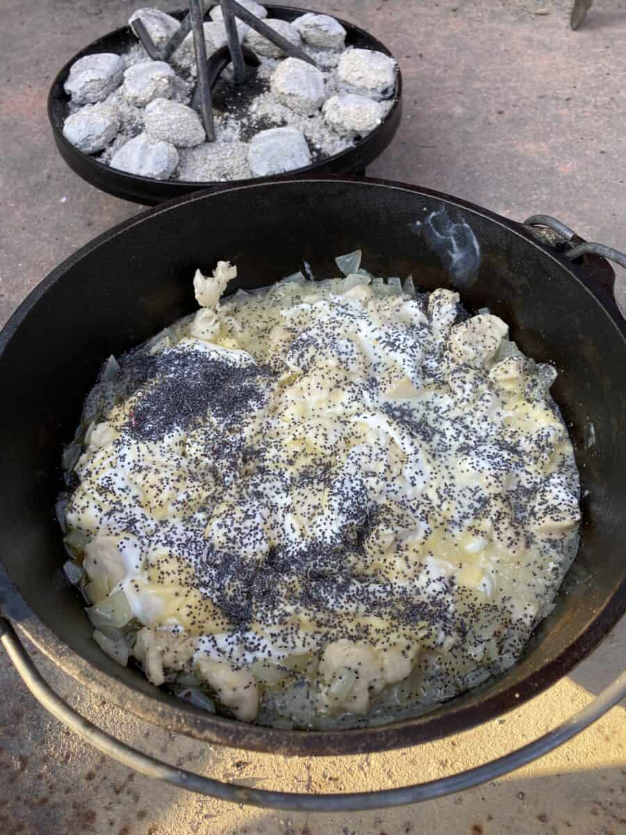 Chicken and onions cooking in a Dutch Oven