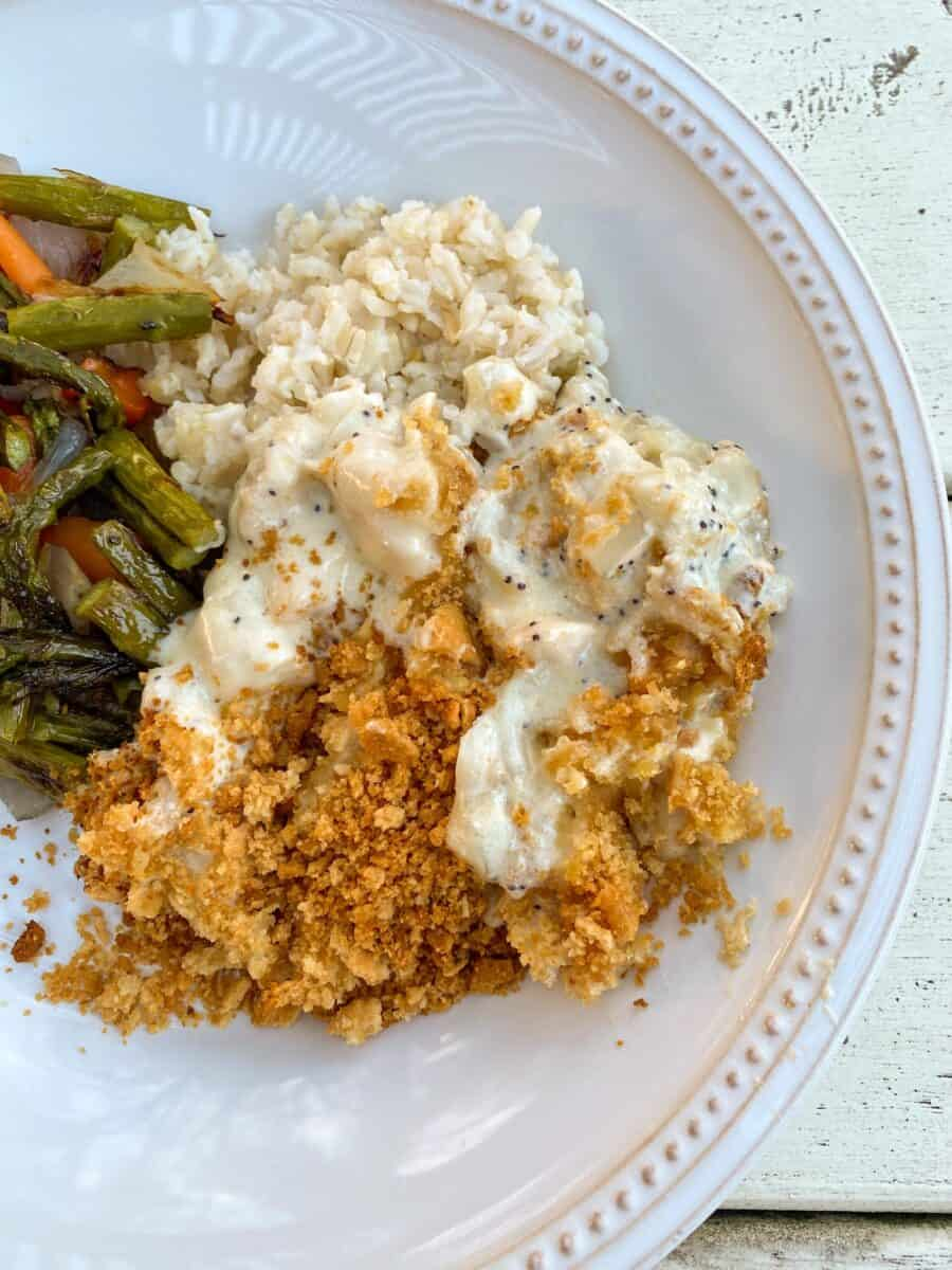 A scoop of chicken with green beans and rice on a plate.