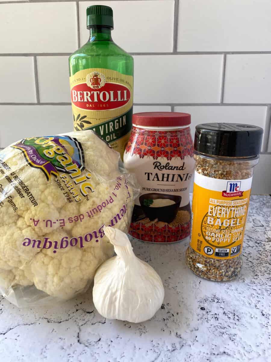 Cauliflower hummus ingredients on a counter.